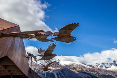 Rusty Birds Over the Mountains