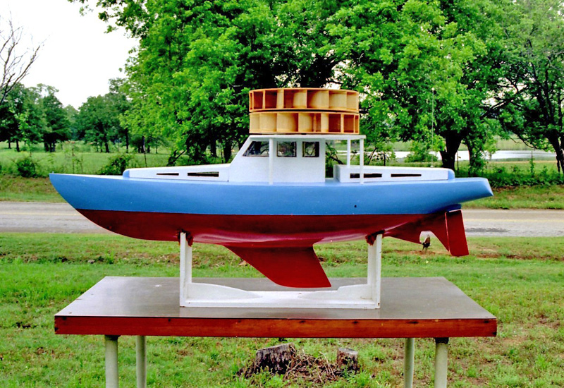 Another view of my Boat. It was also viewed on TV 2 days in a row. It was also featured in A Model Boating Magazine. This was just one of my Hairbrain inventions that I built. I even drew up my own plans to build it. It's 65 inches long.