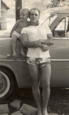 OOPS! Here's me in 1960. I was stationed in Norfolk, Virginia when this was taken. I'm the bigger one. Haha! The little Kid was my Step-Son by my first wife. I've had 4 of them. (wives) Sure don't want any more.
