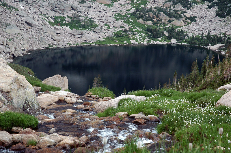 The exceptionally deep waters and high surrounding rock walls create the mysterious alpine tarn known as Black Lake.