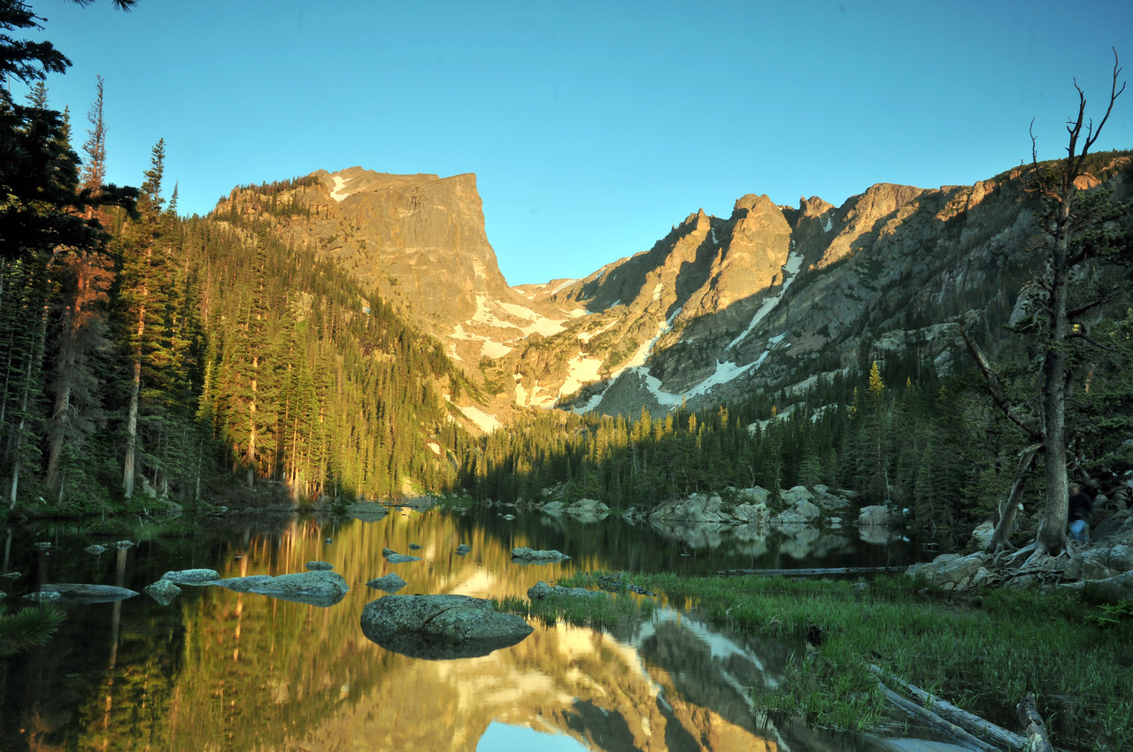 Viewed from Dream Lake Hallet and Flattop mountains glow with the light of a new day.