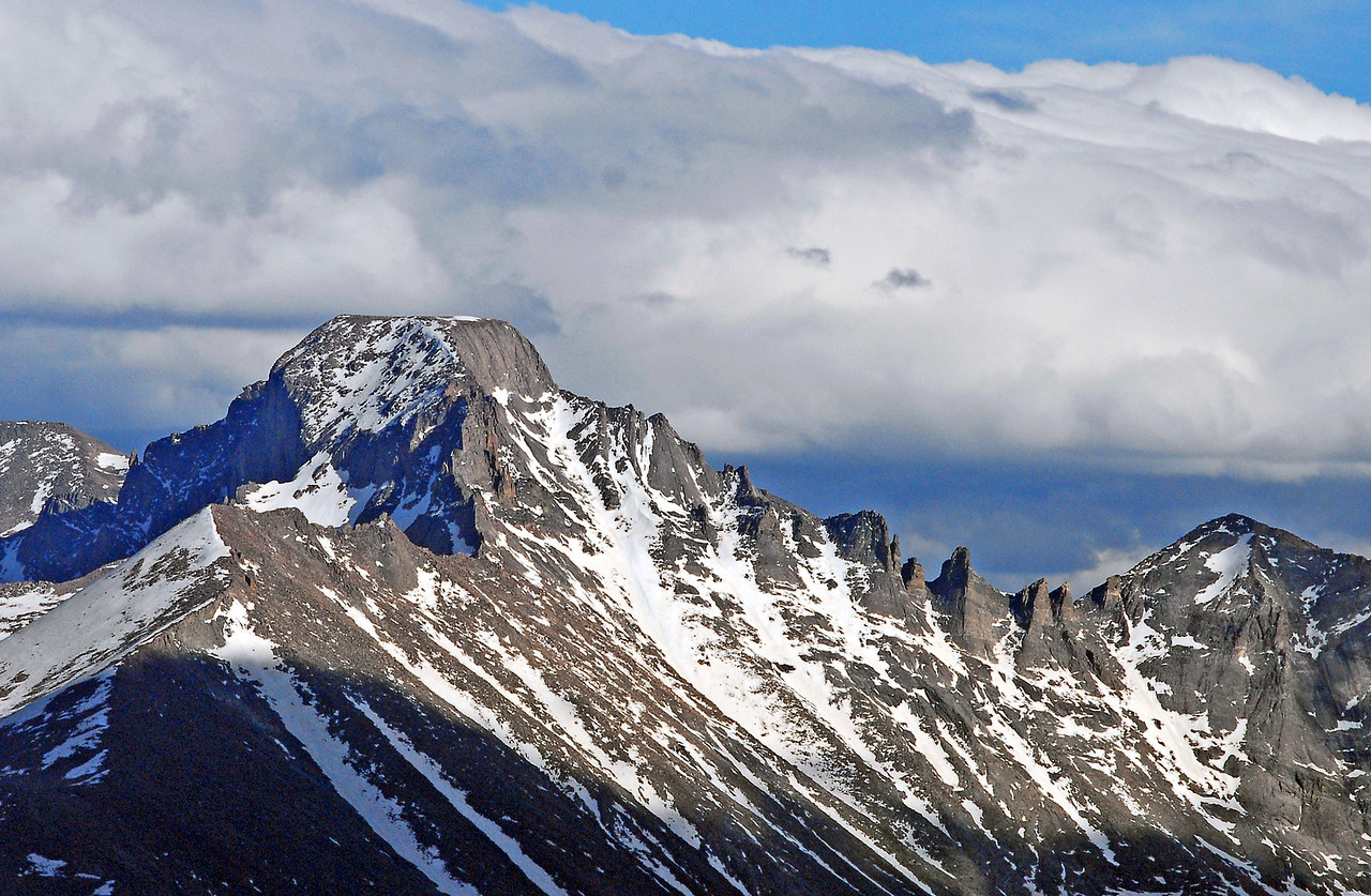 Long's Peak, followed by the Keyboard of the Winds, sheds the last snows of winter.