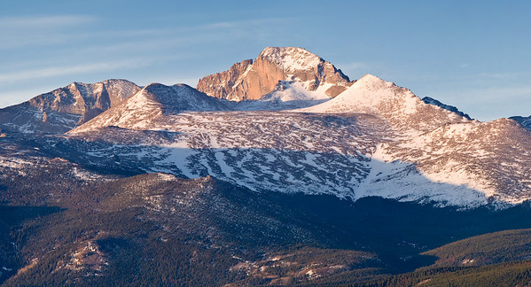 Early morning light illuminates the snow fields approaching Long's Peak in late spring.