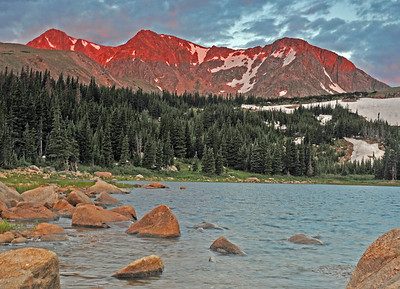 Early morning light burns the mountains above Lost Lake.