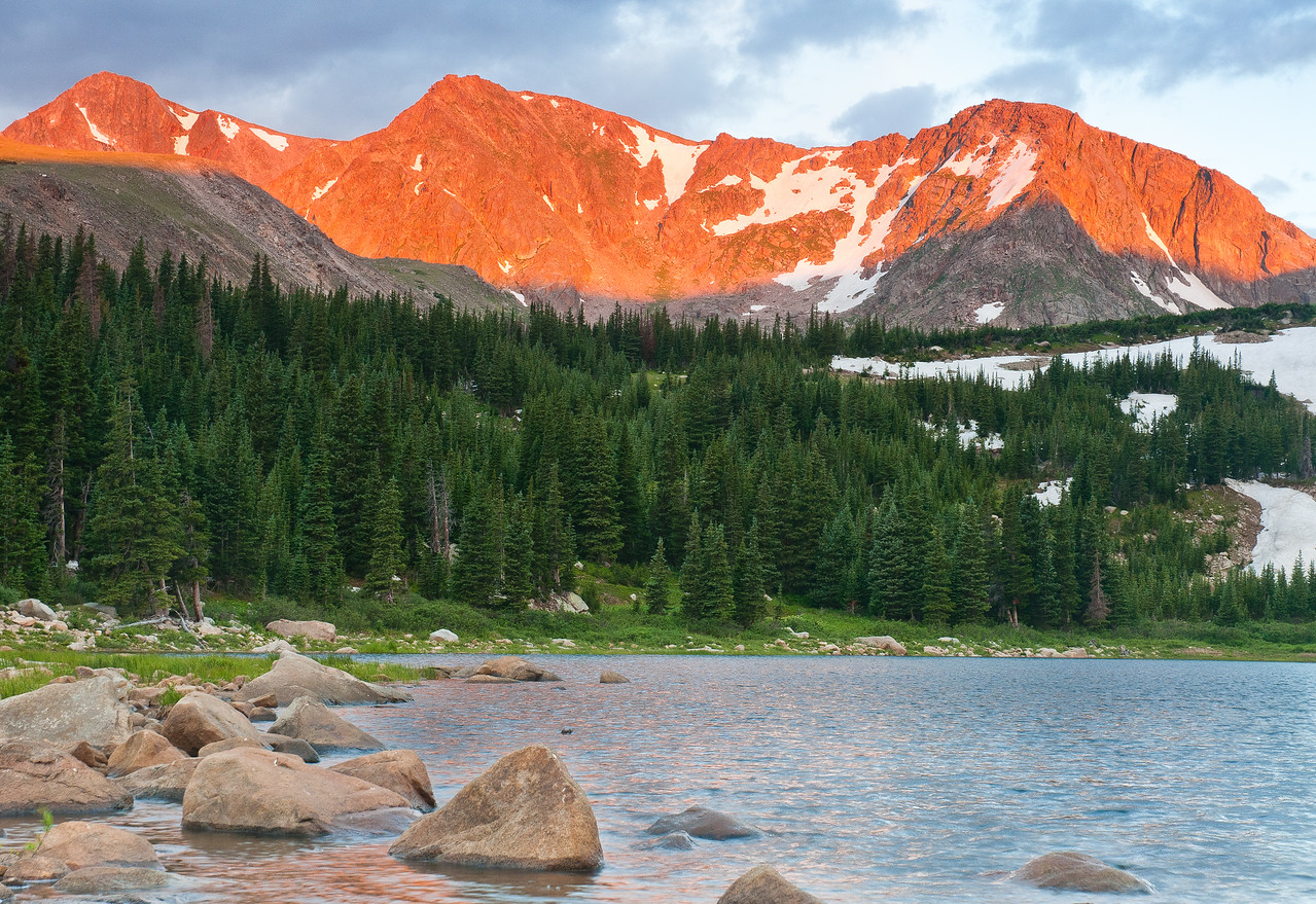 For a final brief moment the light of the new day fires the peaks while wind swept Lost Lake takes on a rosy tint.
