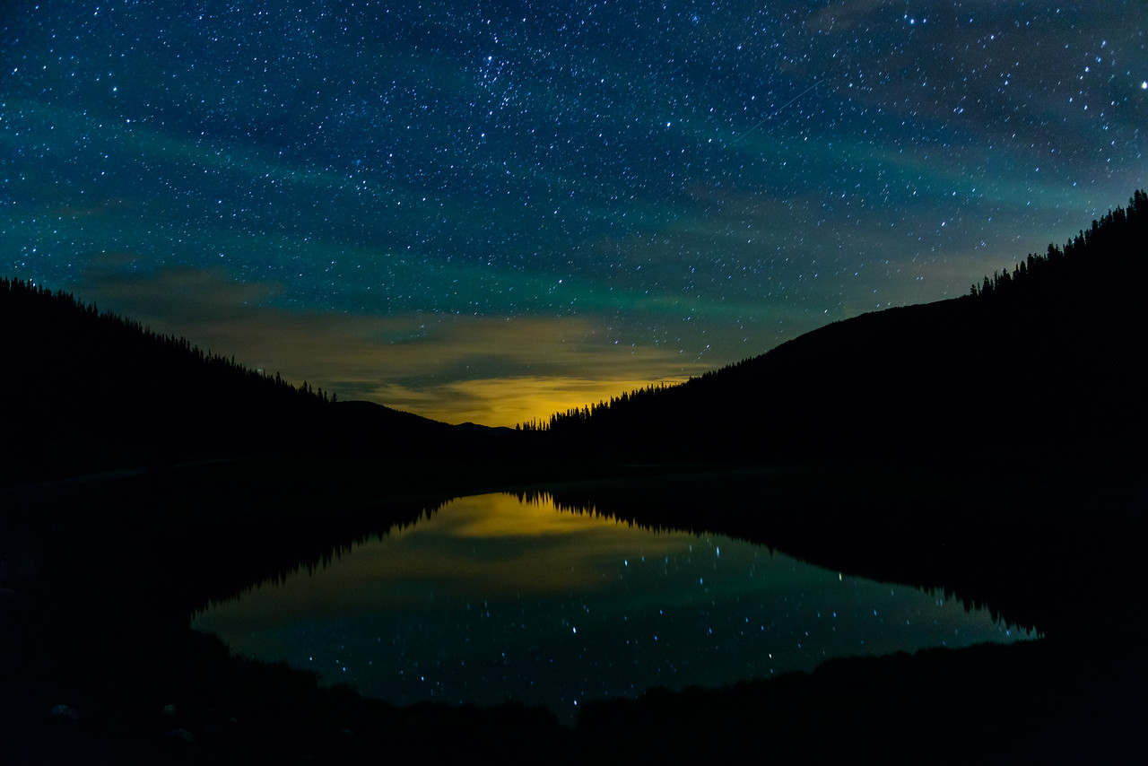 Star light is reflected on the still waters of Poudre Lake just after midnight.