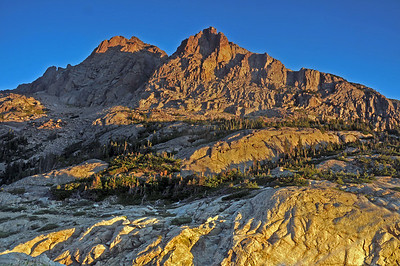 Above the shores of Bluebird Lake the first light of a new day burns the peaks of the continental divide with alpen glow.  Note how quickly the light changes when compared to the next photo.