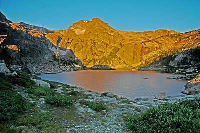 Deep into the wilderness of Wild Basin and nestled beneath the mighty peaks of the Continental Divide is picturesque Bluebird Lake.  It is truly one of Rocky's hidden jewels. At just after 5 a.m.on a cold morning in mid August, the rising sun lights the peaks in a spectacular display of alpen glow.