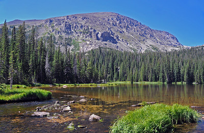 Five miles deep into Wild Basin Ouzel Lake sits beneath the bulk of 13,000 foot Mount Copeland.