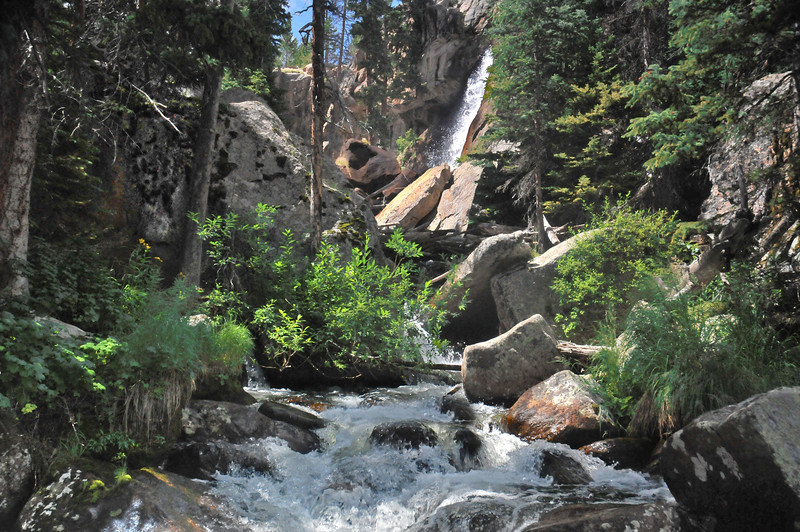 Ouzel Falls is a 40 waterfall located 2.5 miles from the Wild Basin Trailhead.  The falls can be seen from a bridge crossing the trail  (as shown here) but the best views are obtained by scrambling over the rocks to the base of the falls.