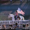 Allison carrying the flag at the Day of the Old West Rodeo