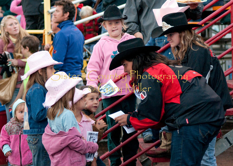 Rodeo Queens attend to their adoring fans.