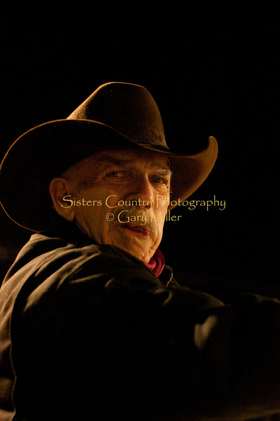 Caught in an eerie light, the weathered face of cowboy Jim Neal has a ghostly aura.