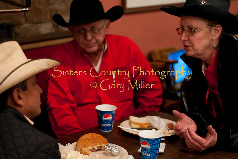 Sisters Rodeo Board Members chat with Charro Tomas Garcilazo