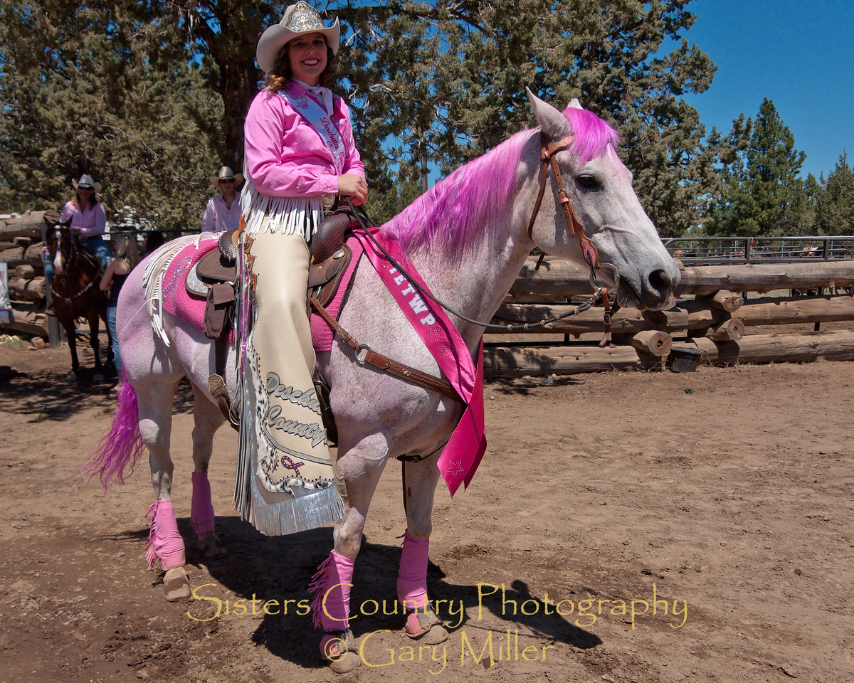 Deschutes County Rodeo Queen Jenna Jacobsen on her beautiful horse Liza are both decked out for the Dare to Wear Pink day at  the 2010 Sisters Rodeo - Gary Miller - Sisters Country Photography
