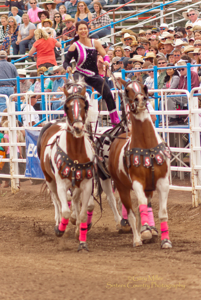 The Sure Shot Acts Trick Riders at the Sisters Rodeo 2011 - Photo by Gary Miller - Sisters Country Photography