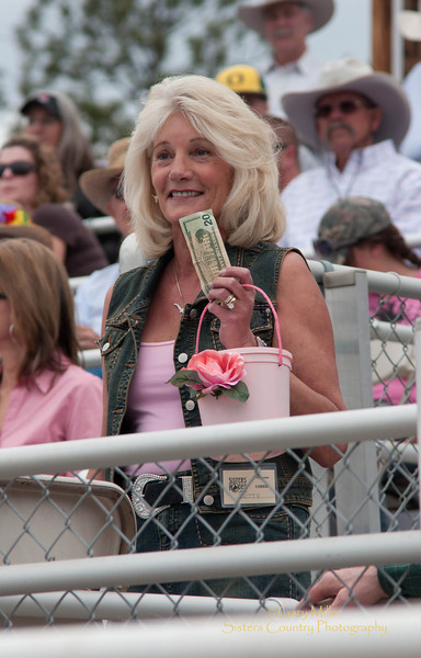 Betty Fadeley collecting money for the Pink Cowboy Cancer Drive - 2011 Sisters Rodeo, Sisters Oregon - Photographer Gary Miller - Sisters Country Photography