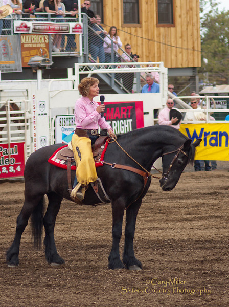 Peggy Tehan Sings the National Anthem at the 2011 Sisters Rodeo Sunday performance - Photo by Gary Miller - Sisters Country Photography