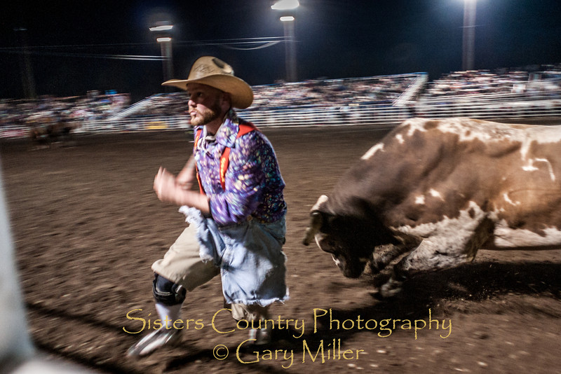 Better be fast bullfighter4! - Saturday night performance at the 2012 Sisters Rodeo -Sisters, Oregon - Gary N. Miller - Sisters Country Photography