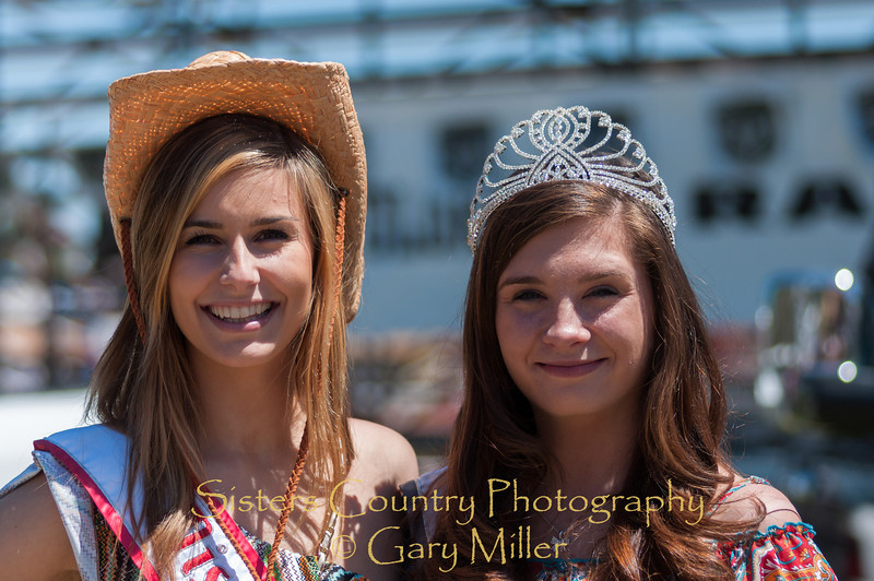 Miss Oregon, Alaina Bergsma, and her beautiful friend take in some cowboy action on Sunday, a picture perfect day at the 2012 Sisters Rodeo -Sisters, Oregon - Gary N. Miller - Sisters Country Photography
