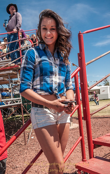 Manisha Haken's radiant smile just may catch a young cowboy's eye or two. Sunday, a picture perfect day at the 2012 Sisters Rodeo -Sisters, Oregon - Gary N. Miller - Sisters Country Photography