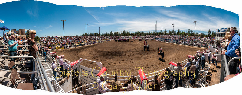 A panoramic view of Peggy Tehan singing the national anthem at the opening ceremony on Sunday, a picture perfect day at the 2012 Sisters Rodeo -Sisters, Oregon - Gary N. Miller - Sisters Country Photography