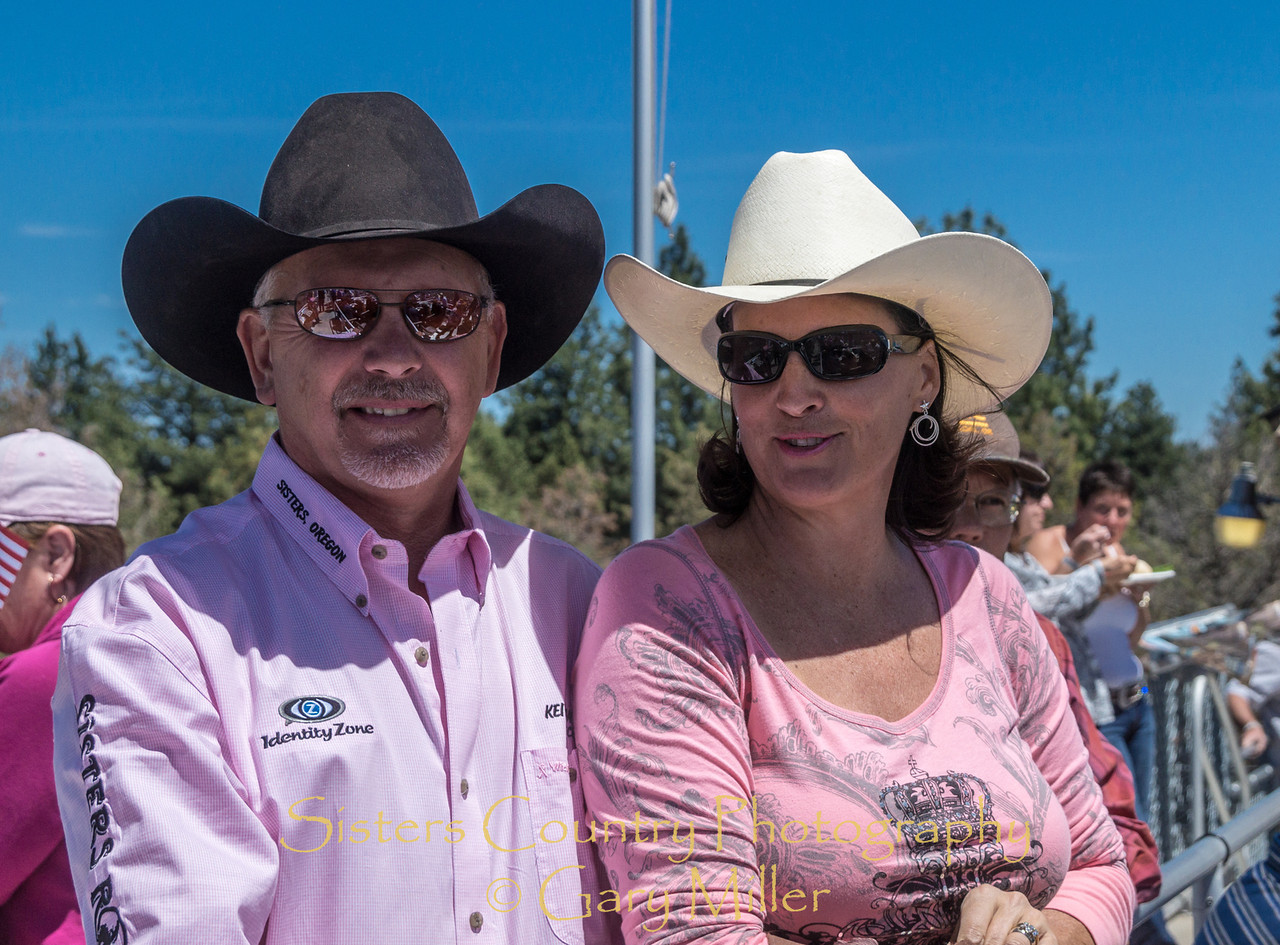 Rodeo Director Keith Sweeney enjoys a moment with his beautiful wife Leigh on Sunday, a picture perfect day at the 2012 Sisters Rodeo -Sisters, Oregon - Gary N. Miller - Sisters Country Photography