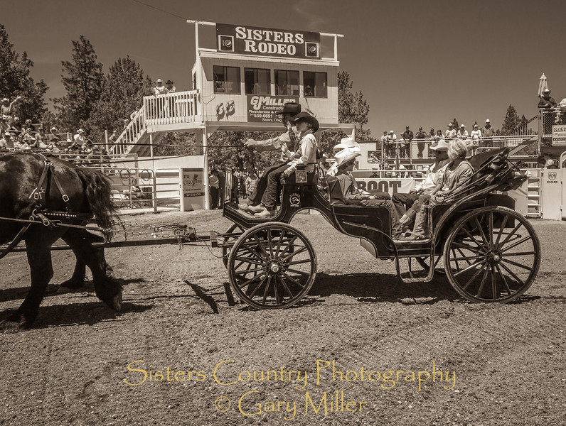 Rodeo Grand Marshall Glenn ( GJ ) Miller and his wife Tove greet the crowd on Sunday, a picture perfect day at the 2012 Sisters Rodeo -Sisters, Oregon - Gary N. Miller - Sisters Country Photography