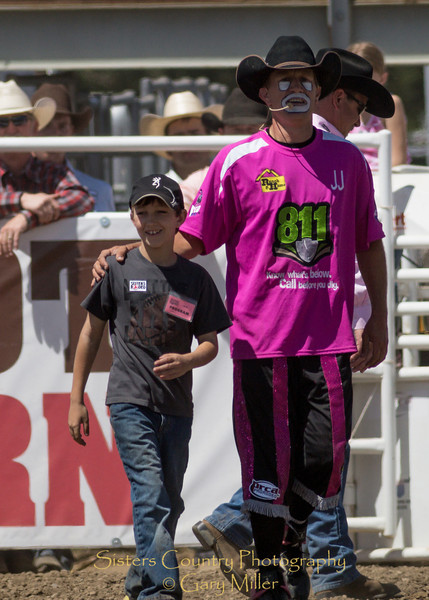 This young man, Levi Georges, set a new Sisters Rodeo record by selling 105 programs himself over the weekend. He was recognized personally by the Rodeo Board and Rodeo Clown J.J. Harrison on Sunday, a picture perfect day at the 2012 Sisters Rodeo -Sisters, Oregon - Gary N. Miller - Sisters Country Photography
