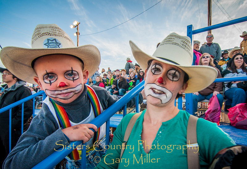 In the spirit. Gavin Peders and his mom, Moriah Peterson are giving rodeo clown JJ Harrison a run for his money with their wonderful garb. PRCA Xtreme Bulls night at the 2012 Sisters Rodeo - Sisters, OR - Gary N. Miller - Sisters Country Photography