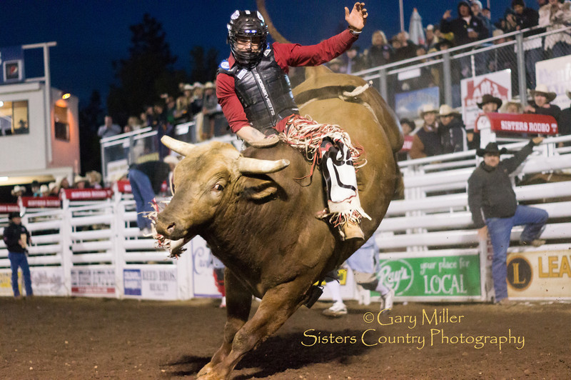 Shane Proctor, coming back from injuries kept him out of the recent limelight, had a fantastic ride as he tied Marty Stanaert's 19-year-old arena record and won the bull riding title with a score of 91 points on Corey & Lange Rodeo Company's Quickstop at the Saturday night performance at the 2012 Sisters Rodeo -Sisters, Oregon - Gary N. Miller - Sisters Country Photography