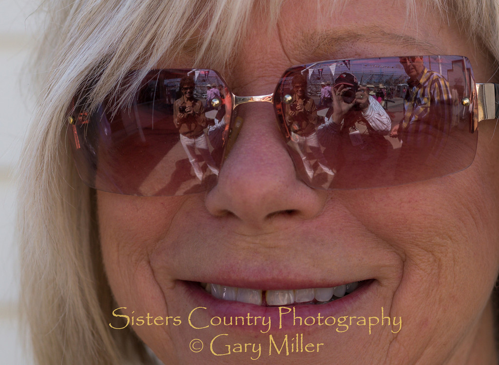 Tove Miller, Grand Marshall and Rodeo President GJ Miller's much more beautiful half. Reflections in her glasses are of her sisters and brother-in-law flanking photographer Gary Miller - Sunday, a picture perfect day at the 2012 Sisters Rodeo -Sisters, Oregon - Gary N. Miller - Sisters Country Photography