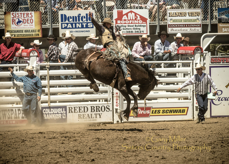 Saddle Bronc rider Jesse Kruse from Great Falls, Montana at Saturday afternoon's performance of the 2013 Sisters Rodeo - Sisters, Oregon - Copyright © 2013 Gary N. Miller, Sisters Country Photography