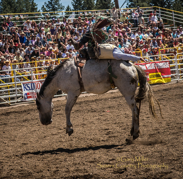 Ryan Gray of Cheney Washington rides to a  2nd place finish with a score of 84 Sunday afternoon's performance of the 2013 Sisters Rodeo - Sisters, Oregon - Copyright © 2013 Gary N. Miller, Sisters Country Photography