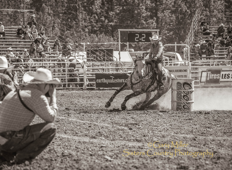 Barrel Racer Barbra West of Oak Harbor, Washington  at Sunday afternoon's performance of the 2013 Sisters Rodeo - Sisters, Oregon - Copyright © 2013 Gary N. Miller, Sisters Country Photography