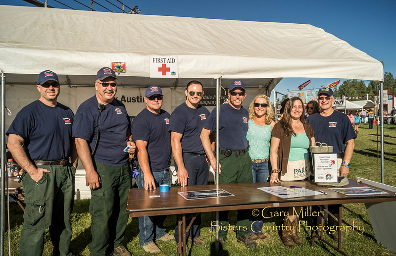 Cloverdale Fire Vounteers working their raffle booth at Friday night's performance of the 2013 Sisters Rodeo - Sisters, Oregon - Copyright © 2013 Gary N. Miller, Sisters Country Photography