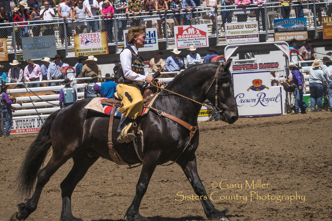 Peggy Tehan sings the National Anthem while astride her new award winning Friesian steed - Saturday afternoon's performance of the 2013 Sisters Rodeo - Sisters, Oregon - Copyright © 2013 Gary N. Miller, Sisters Country Photography