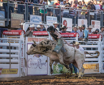 Cody Campbell rides at the Wednesday Bull Extravaganza night at the 2013 Sisters Rodeo - Sisters, Oregon - Copyright © 2013 Gary N. Miller, Sisters Country Photography