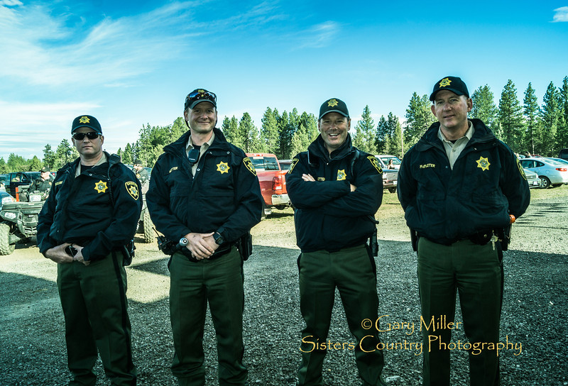Deschutes County Sheriffs Officers keep smiling eyes out on Friday night at the 2014 Sisters Rodeo - Sisters, Oregon © 2014 Gary N. Miller, Sisters Country Photography