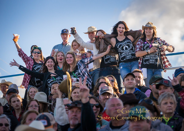 A bachlorette party eagle-eyes all the great looking guys at the Saturday Night Performance of the 2016 Sisters Rodeo © Gary N. Miller, Sisters Country Photography