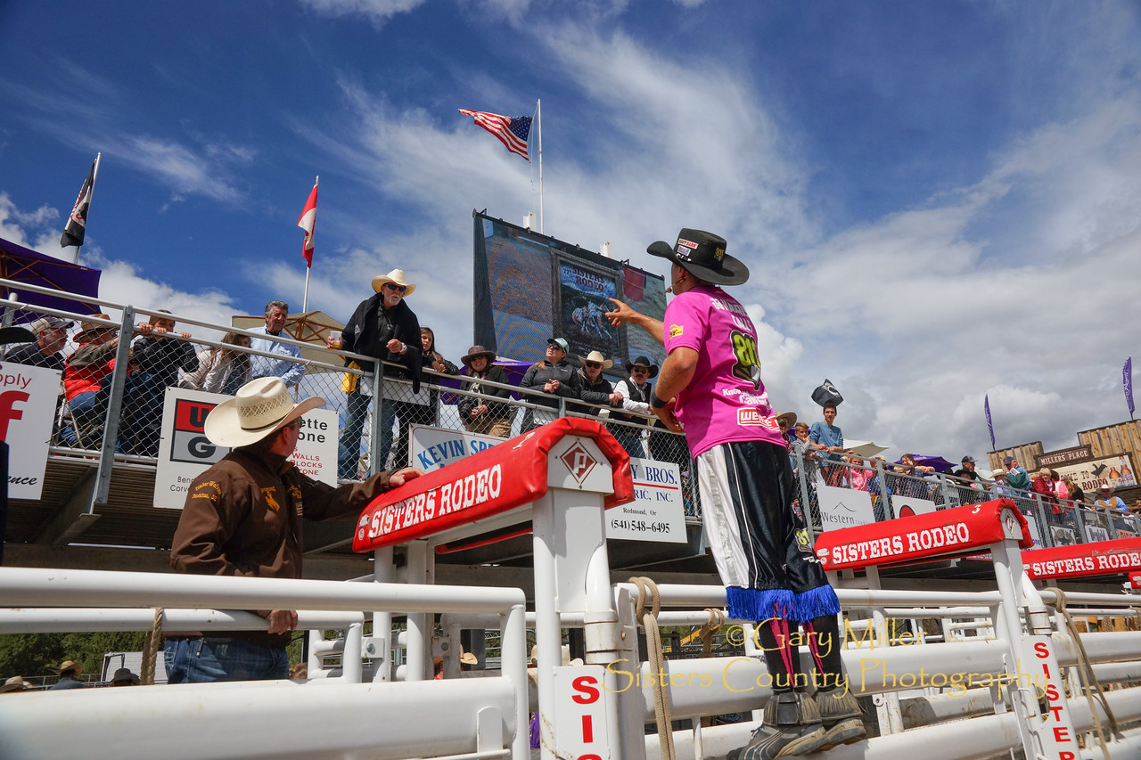Rodeo Clown JJ Harrison congratulates Bill Willitts of the Fivepine Lodge, the winning bidder on the Proud to Wear Pink auction for cance on Sunday afternoow at the 2017 Sisters Rodeo © 2017  Gary N. Miller, Sisters Country Photography