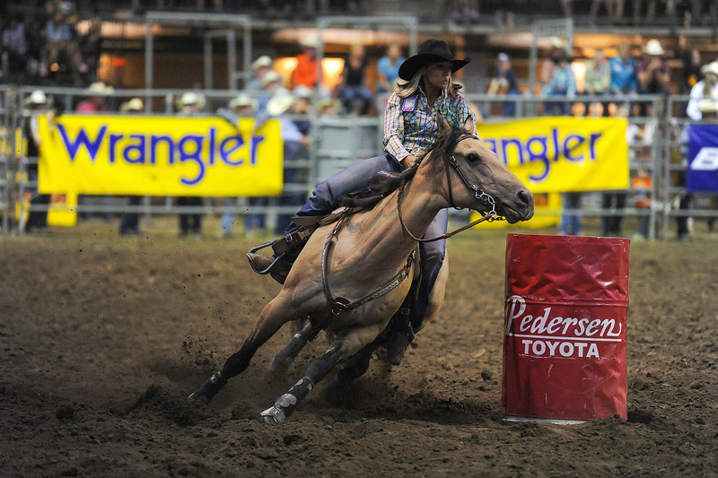 Sarah Tittel of Pueblo, CO participates in the barrel racing event at the Larimer County Fair Rodeo in Loveland on Aug. 8, 2016.<br /> <br /> Photo by Michael Ortiz/ Loveland Reporter-Herald