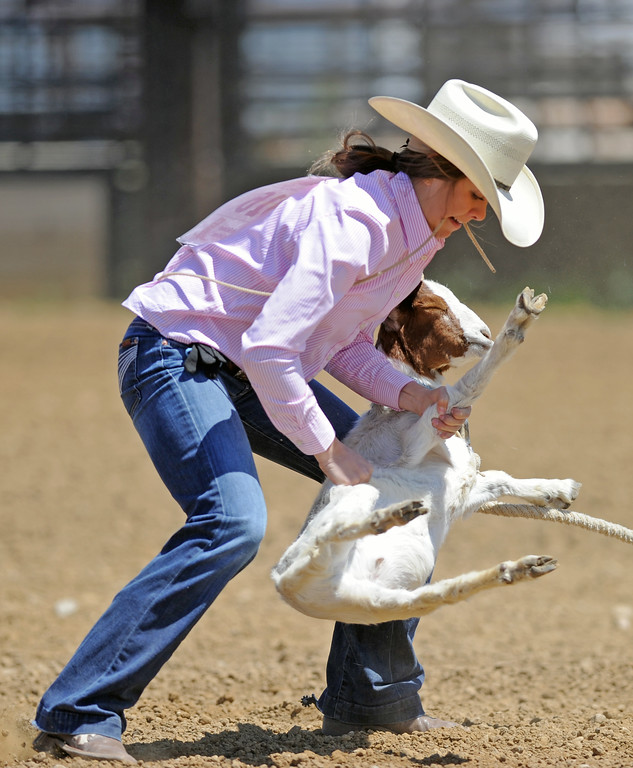 Ellie Bard flips a goat to its back during the Sheridan County high school rodeo on Sunday, May 28 at the Sheridan County Fairgrounds. Mike Pruden | The Sheridan Press