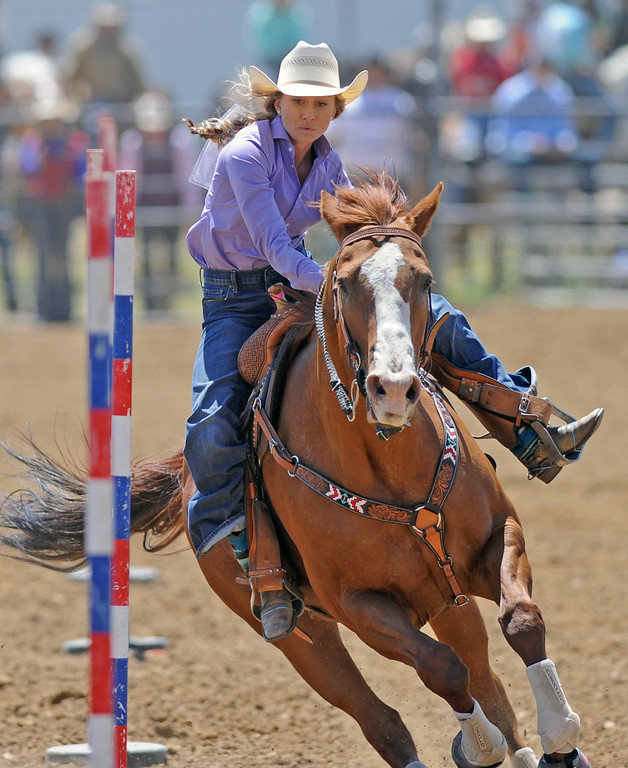 Mckenna Balkenbush guides her horse through the pole-bending course during the Sheridan County high school rodeo on Sunday, May 28 at the Sheridan County Fairgrounds. Mike Pruden | The Sheridan Press