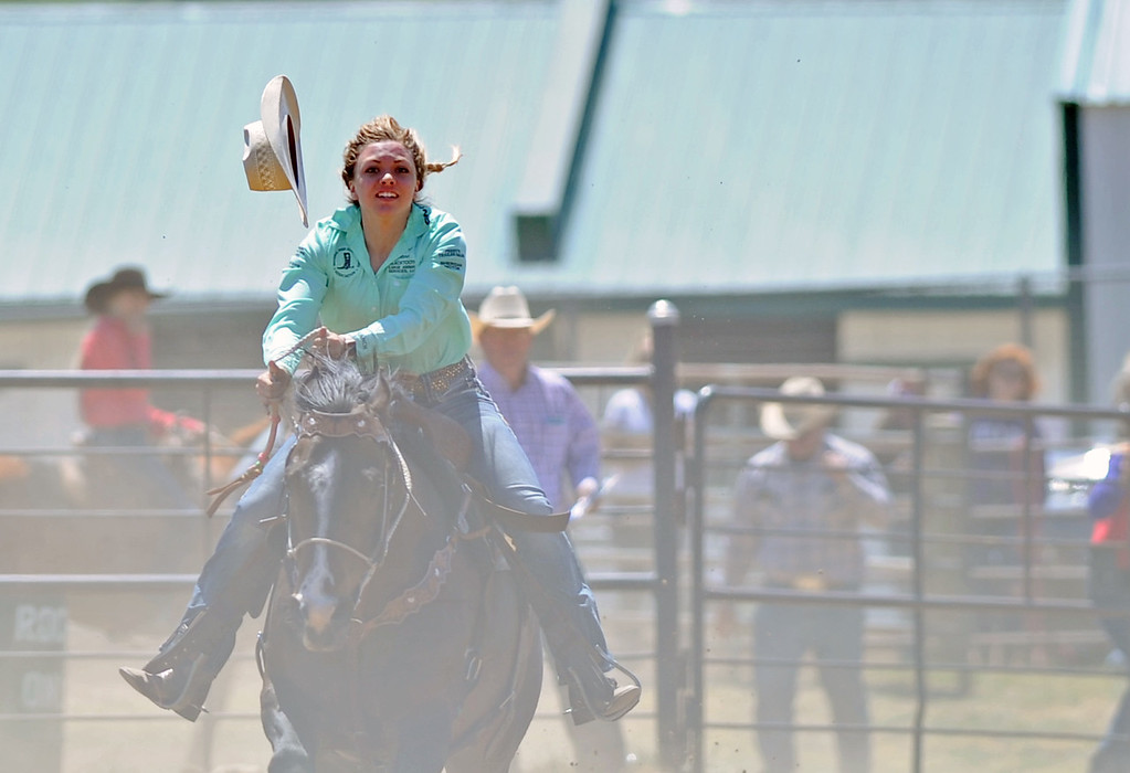 Anna Zowada loses her hat in the pole-bending competition during the Sheridan County high school rodeo on Sunday, May 28 at the Sheridan County Fairgrounds. Mike Pruden | The Sheridan Press