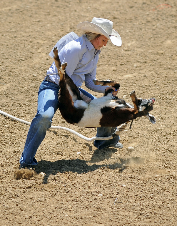 Bailey Cunningham takes her goat to the ground in the goat-tying event during the Sheridan County high school rodeo on Sunday, May 28 at the Sheridan County Fairgrounds. Mike Pruden | The Sheridan Press