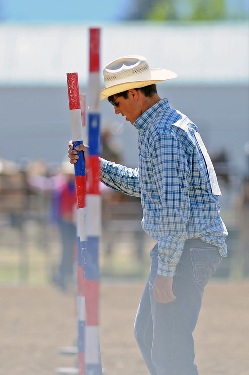 Wheaton Williams straightens a pole for the pole-bending competition during the Sheridan County high school rodeo on Sunday, May 28 at the Sheridan County Fairgrounds. Mike Pruden | The Sheridan Press