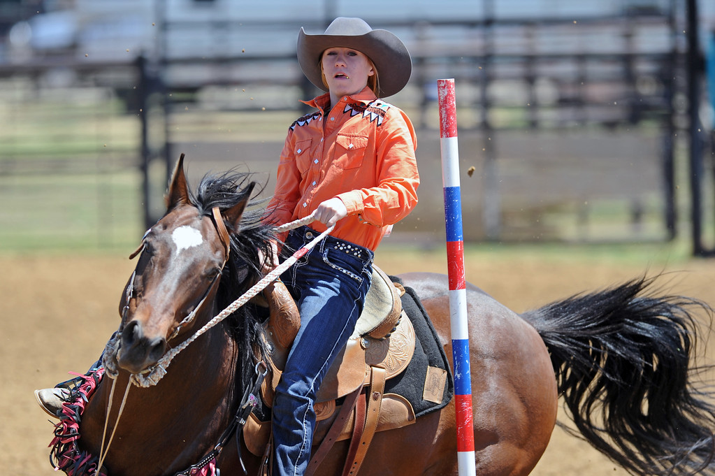 Shaylee Adamson turns around a pole during the Sheridan County high school rodeo on Sunday, May 28 at the Sheridan County Fairgrounds. Mike Pruden | The Sheridan Press