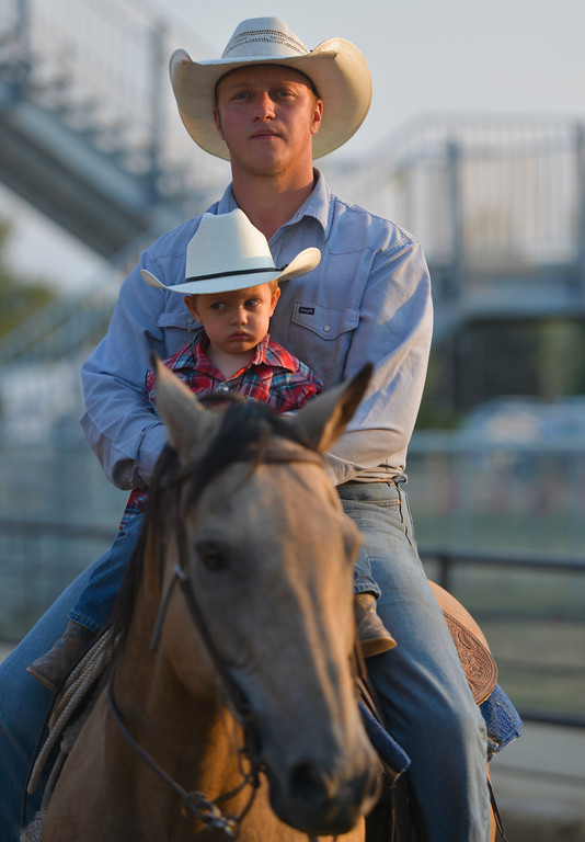 Justin Sheely | The Sheridan Press<br /> Daniel Bell holds his sleepy son Dallen Bell, 1, during the Sheridan County Rodeo Saturday at the Sheridan County Fairgrounds.