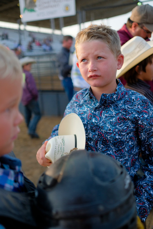 Justin Sheely | The Sheridan Press<br /> Eight-year-old Chase Garber waits behind the calf bucking chutes during the Sheridan County Rodeo Saturday at the Sheridan County Fairgrounds.